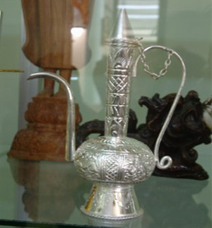 An ornate silver jug for Laos Whiskey.